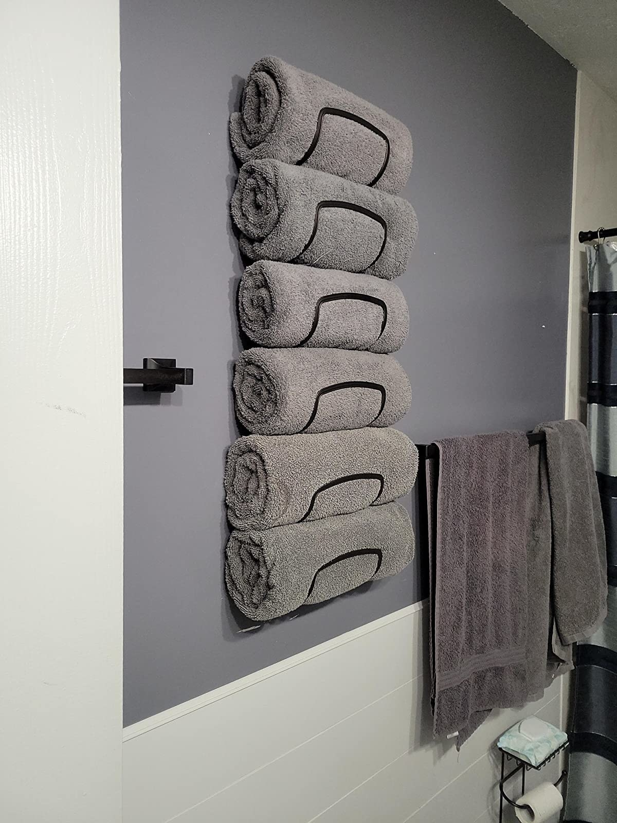 reviewer's towel rack holding six grey towels