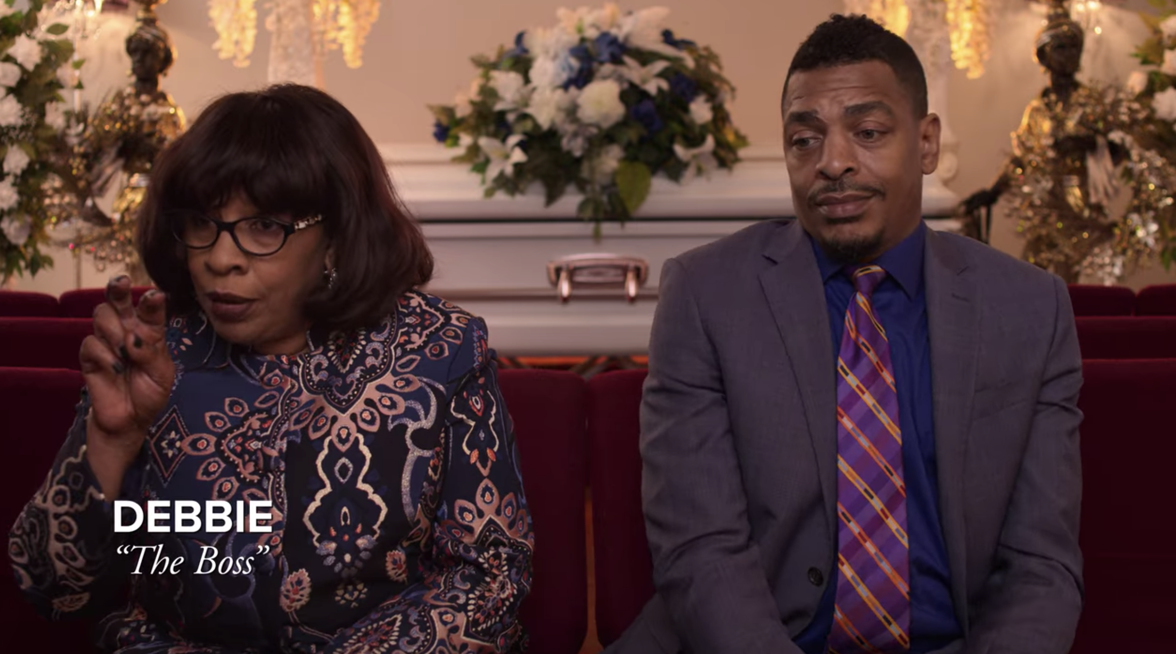 Debbie and Ryan Bernard sitting in a funeral home