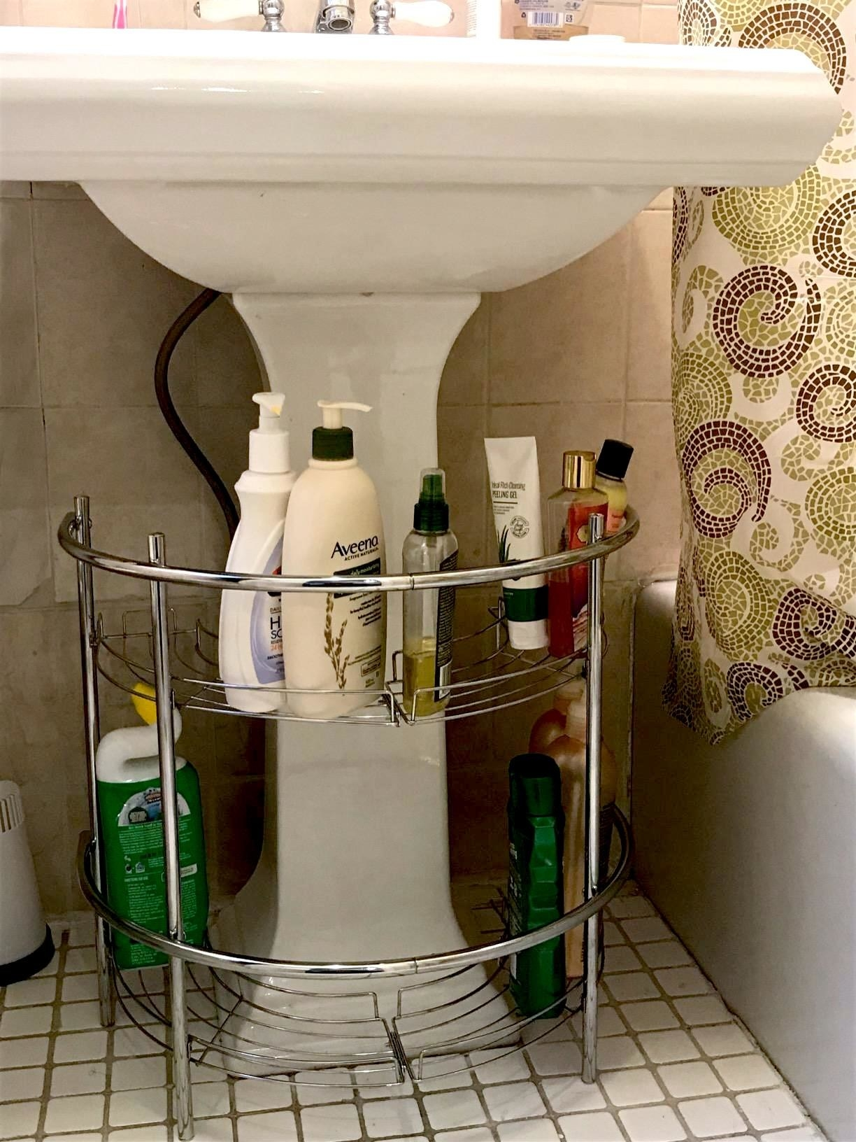 reviewer's under cabinet storage rack with bath products