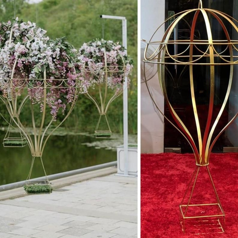 golden wire hot air balloon with a space for flowers to sit at the top and in the square part of the bottom of the hot air balloon