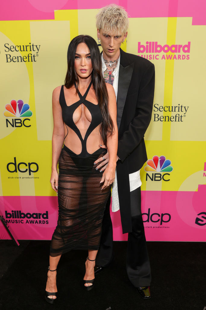 Megan Fox (L) and Machine Gun Kelly poses backstage for the 2021 Billboard Music Awards