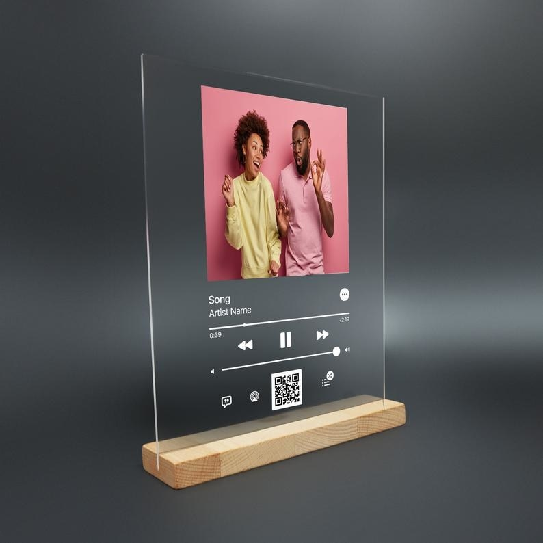 clear acrylic song plaque that looks like the screens on a music streaming app