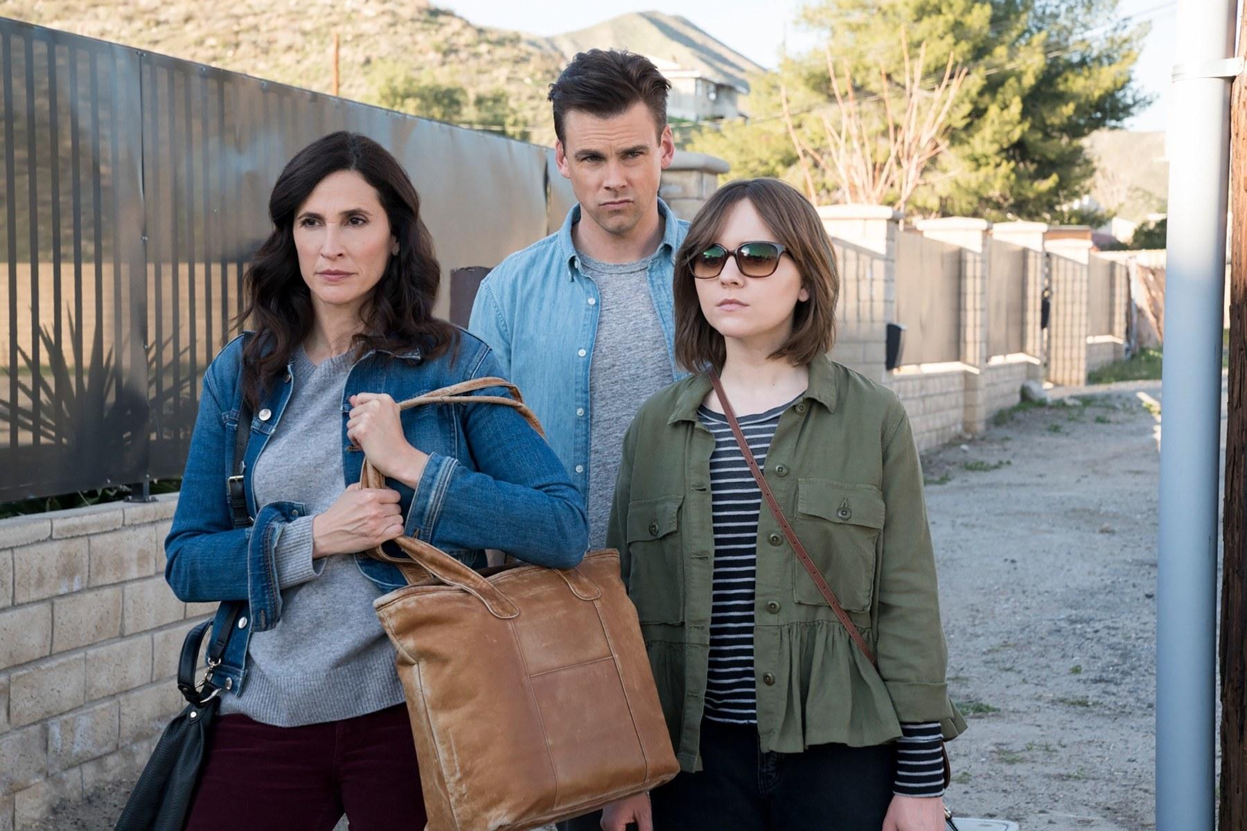 Michaela Watkins, Tommy Dewey, and Tara Lynne Barr walking together