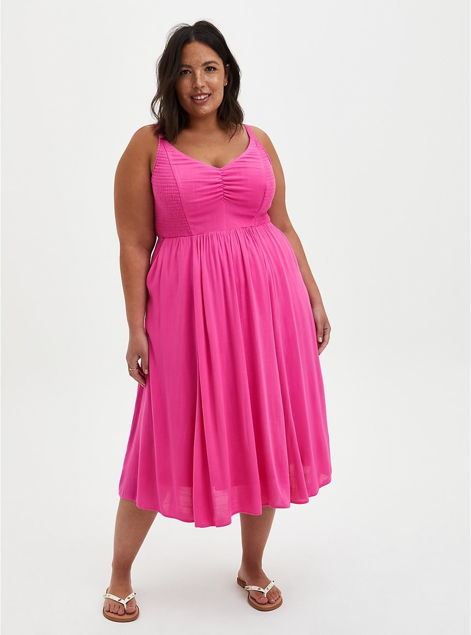 a model wearing the bright pink dress