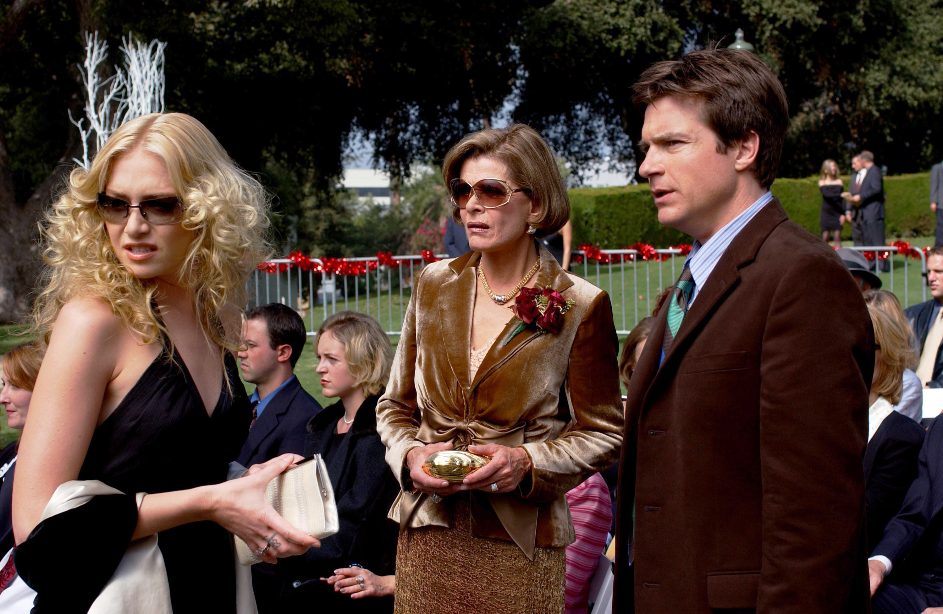 Portia de Rossi, Jessica Walter, and Jason Bateman staring at something with great confusion