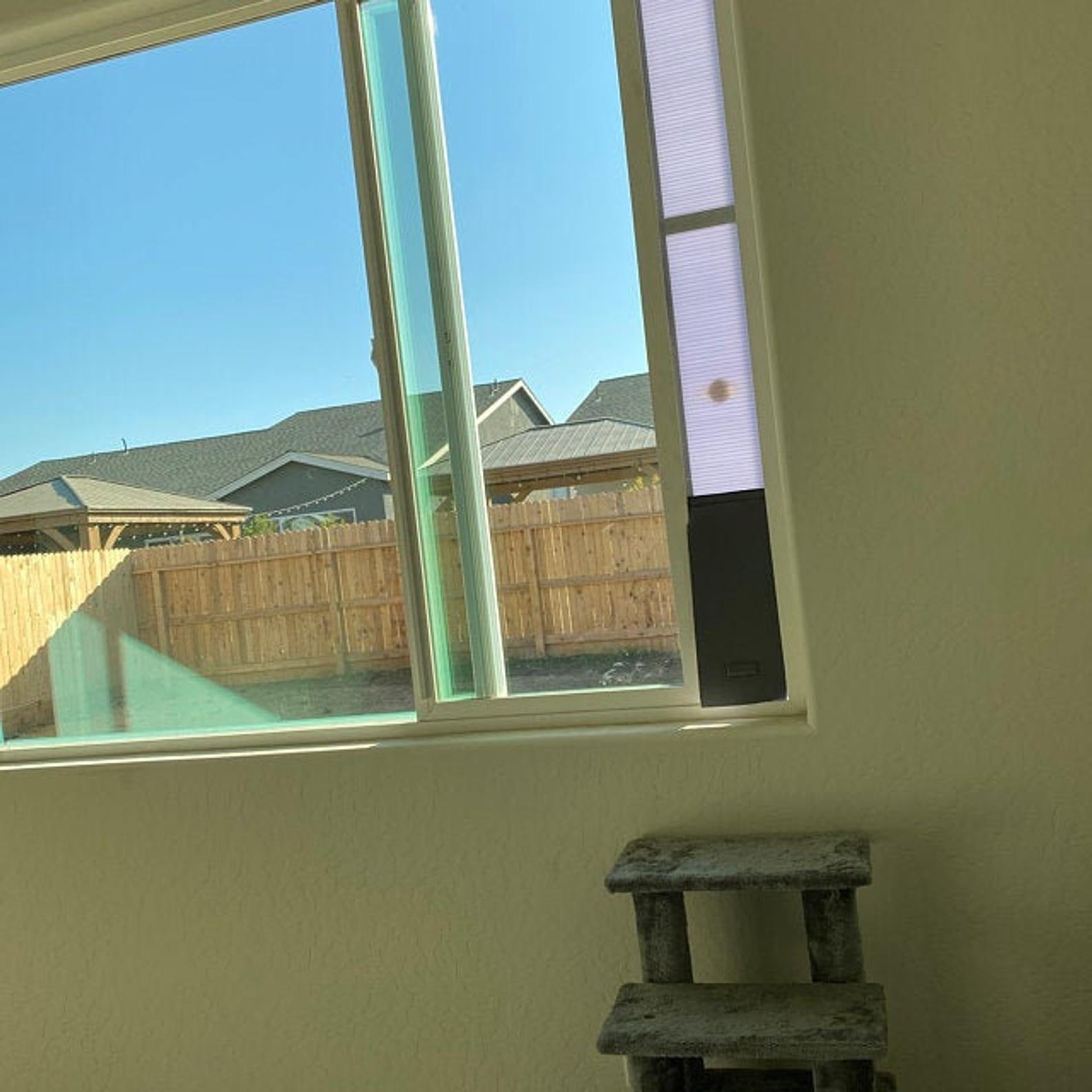 The pet door is installed on a window