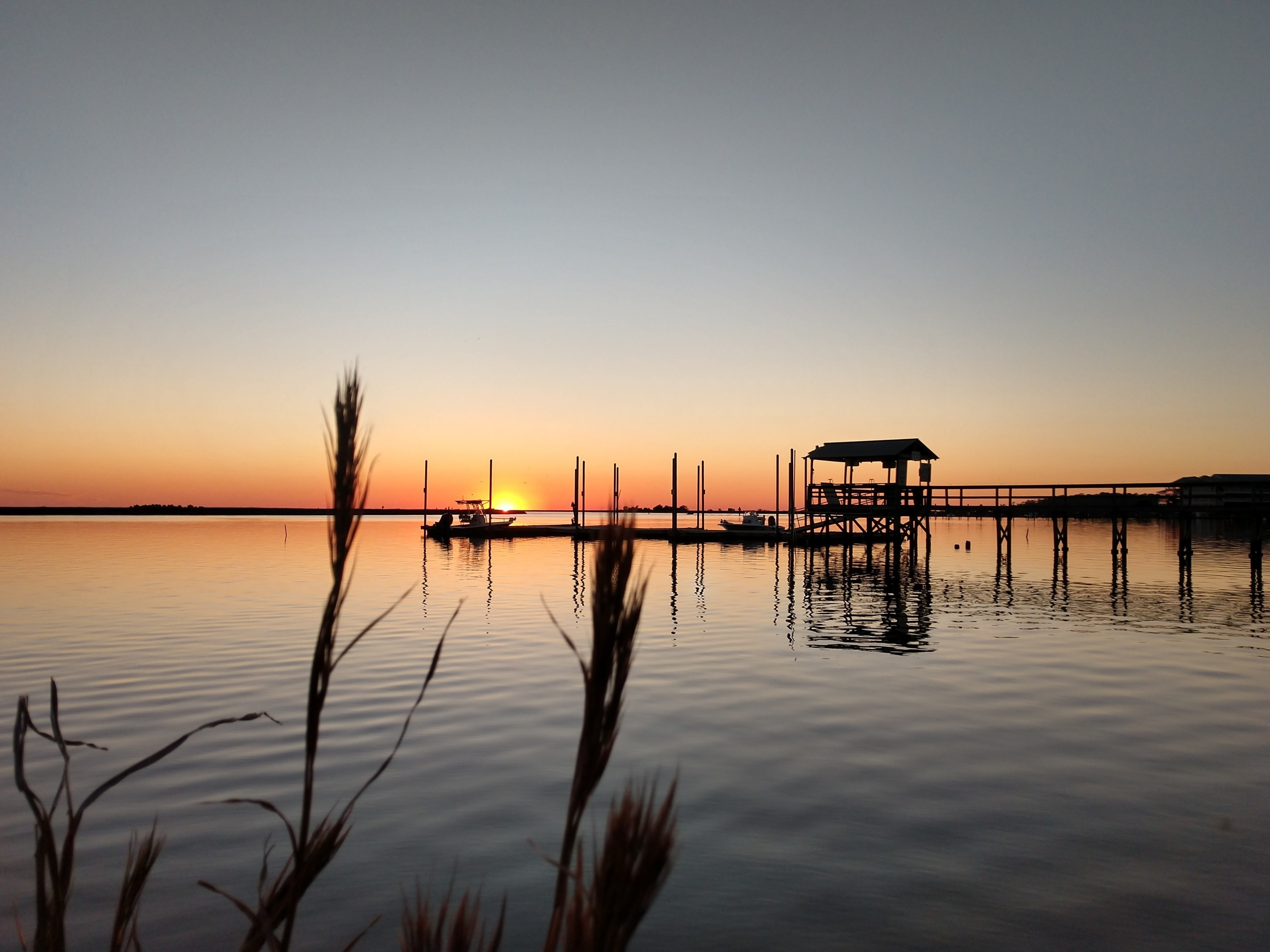 Photo of water, dock, and sunset in Steinhatchee