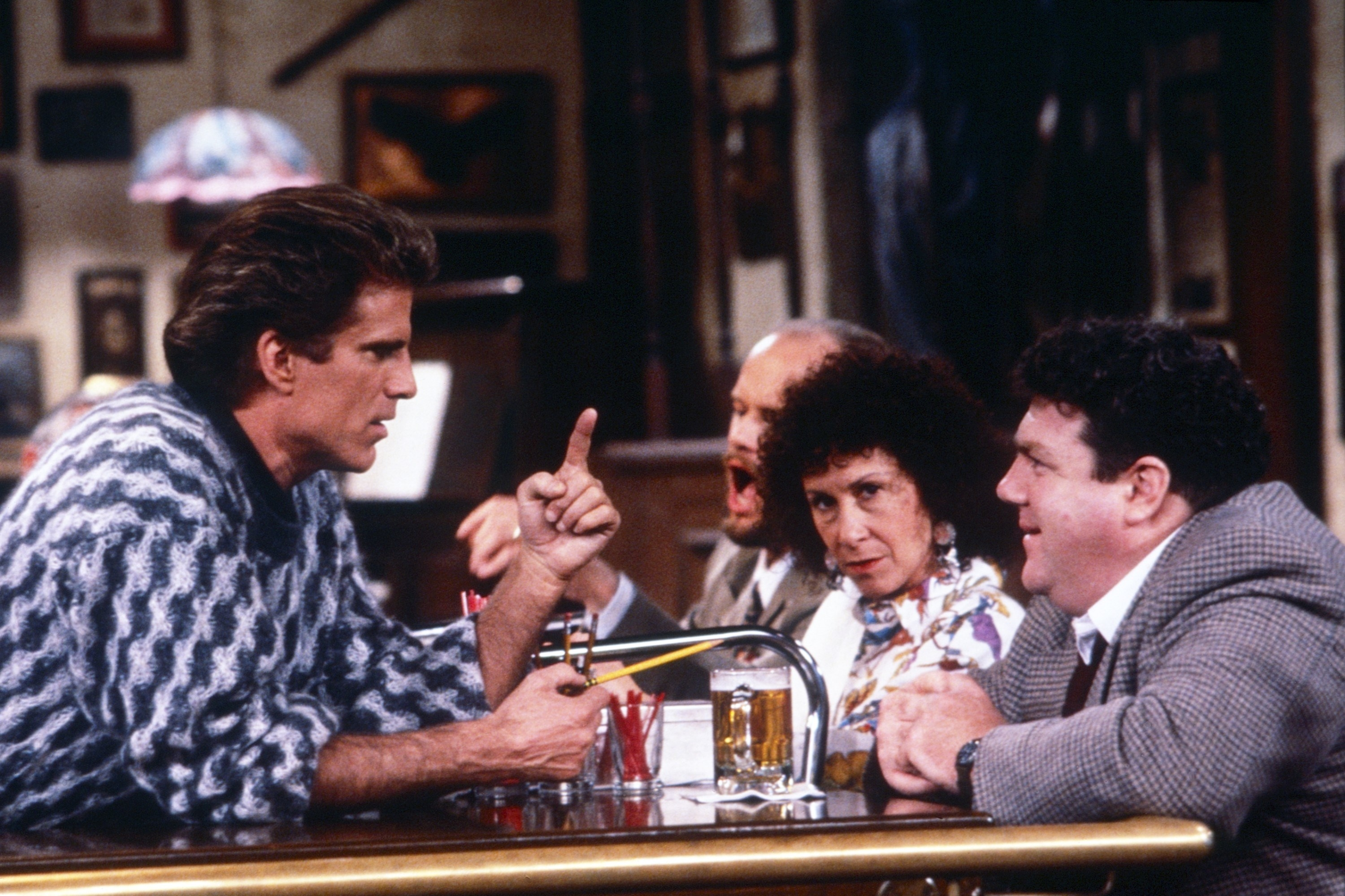 Ted Danson, Rhea Perlman, and George Wendt chatting at the bar
