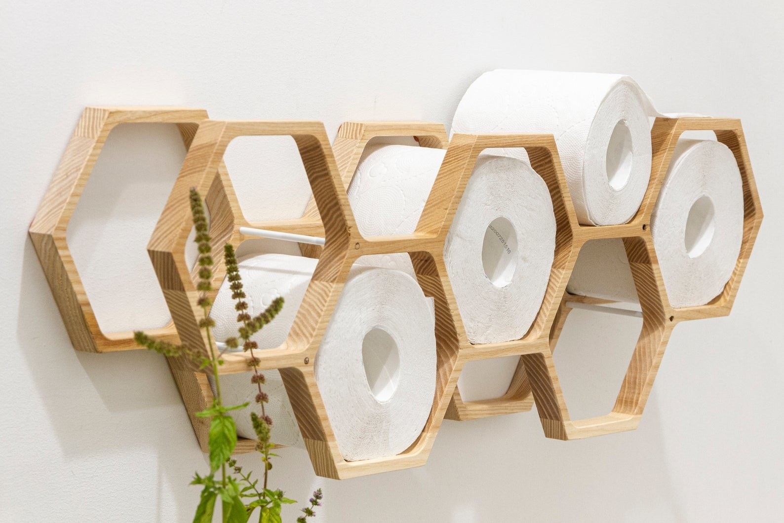 honeycomb-shaped organizer packed with toilet paper
