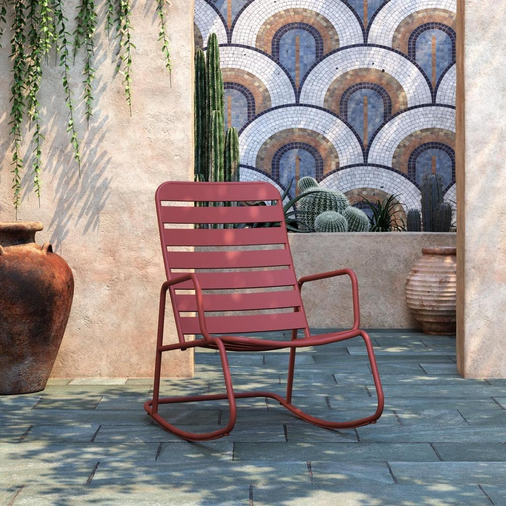 the red chair on stone patio