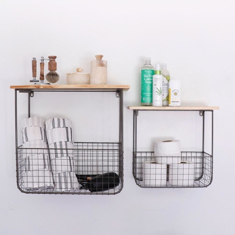 two floating shelves, both with wire baskets underneath both