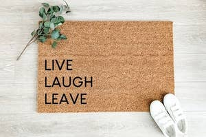 doormat that says live laugh leave