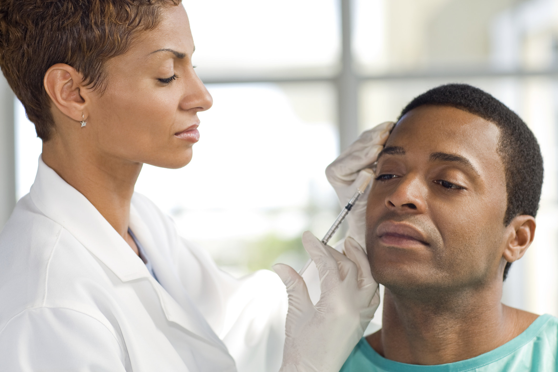 A doctor giving a man Botox injections