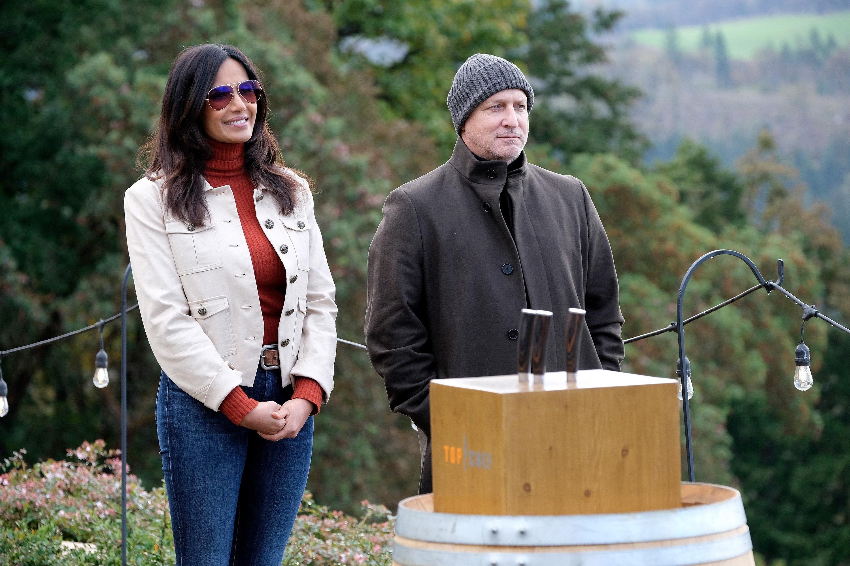 Padma Lakshmi andTom Colicchio standing together