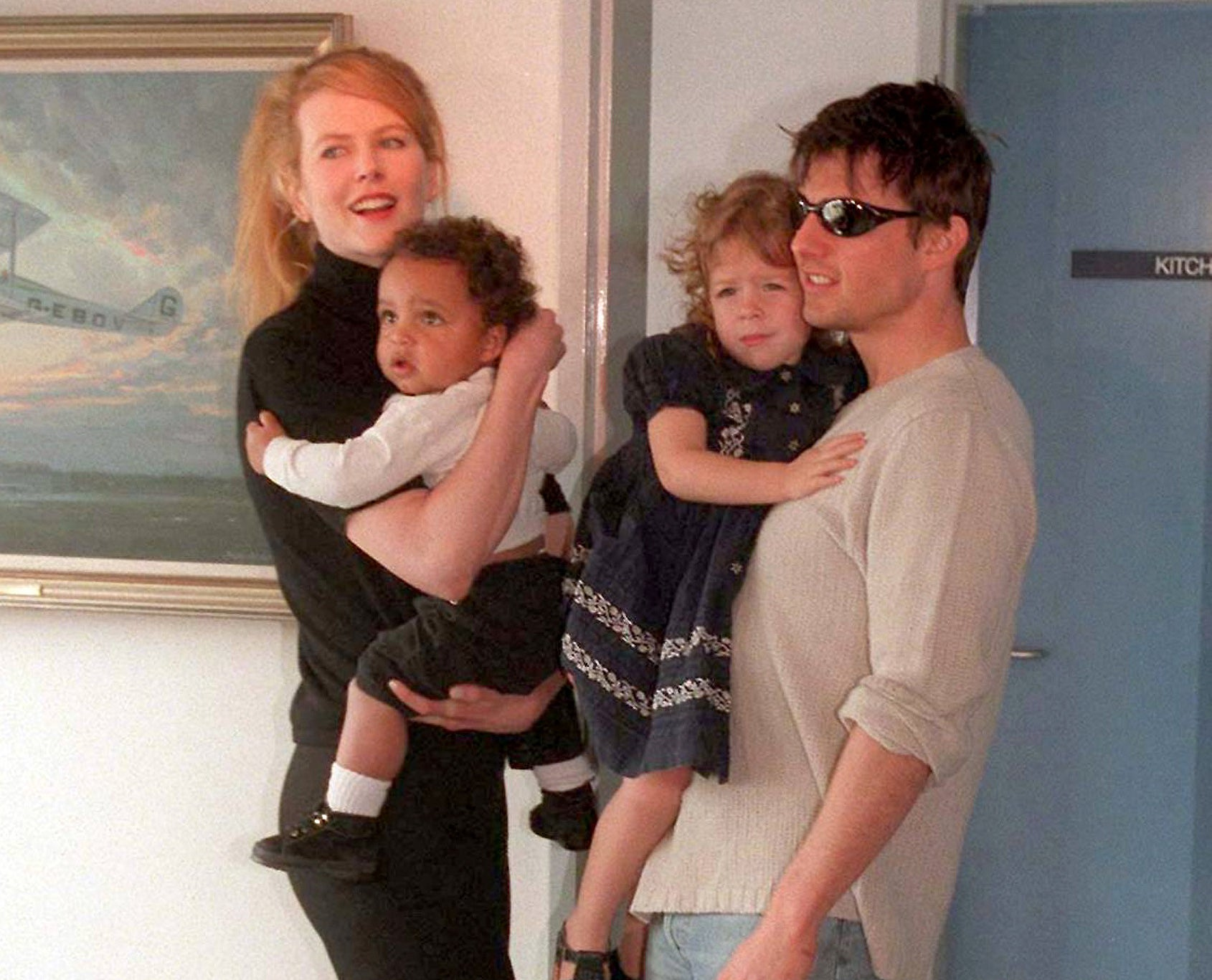 An old photo of Tom and Nicole holding Bella and Connor as toddlers