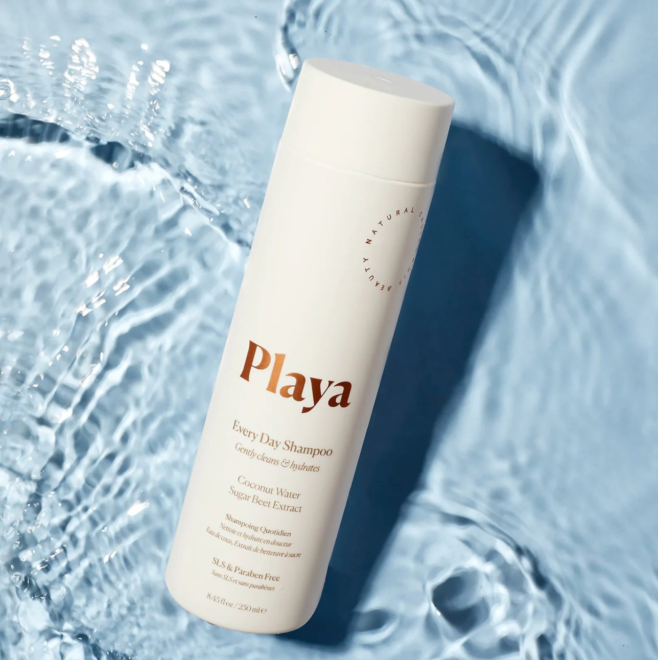 Playa everyday shampoo bottle against water