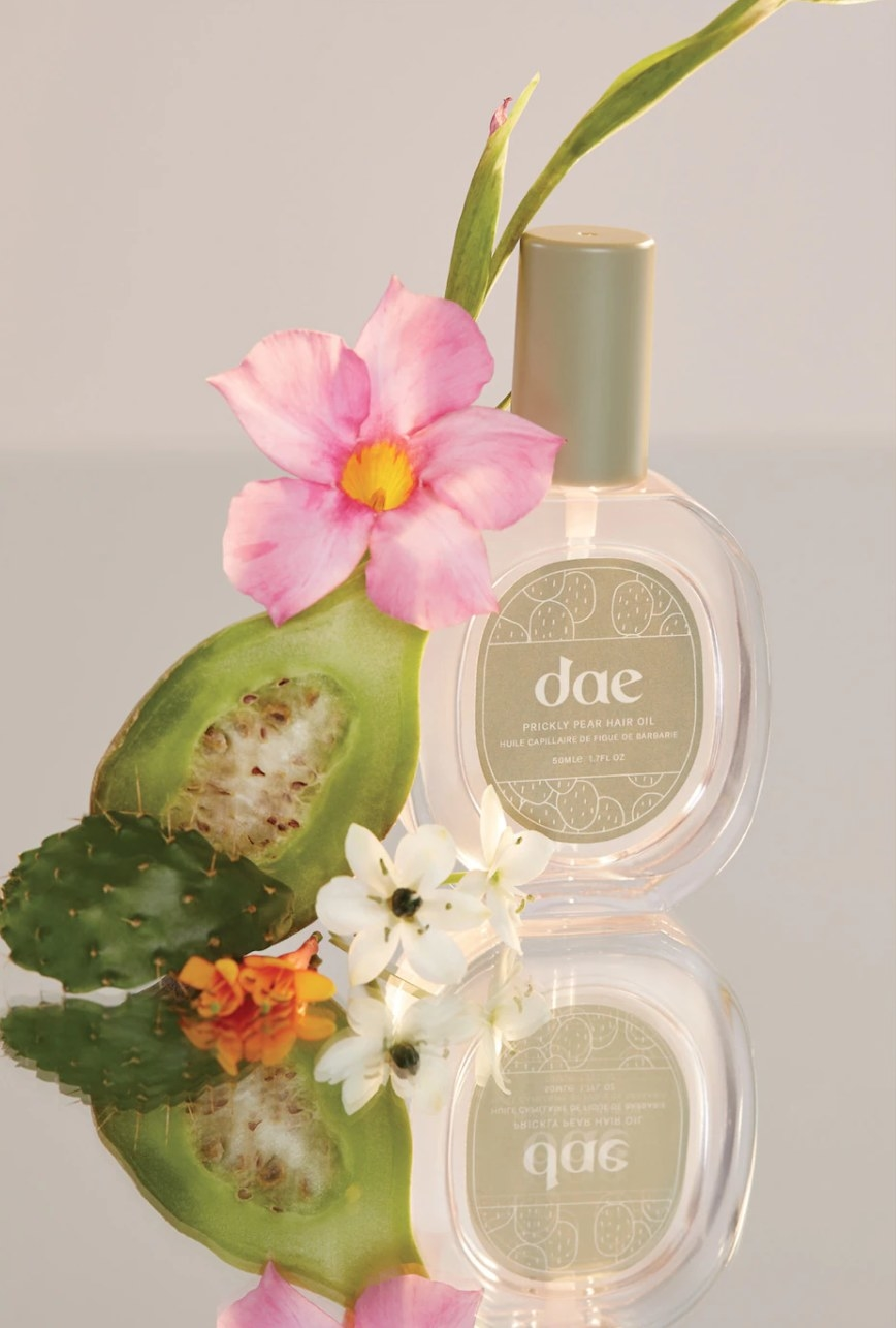Bottle of Dae oil next to cactus