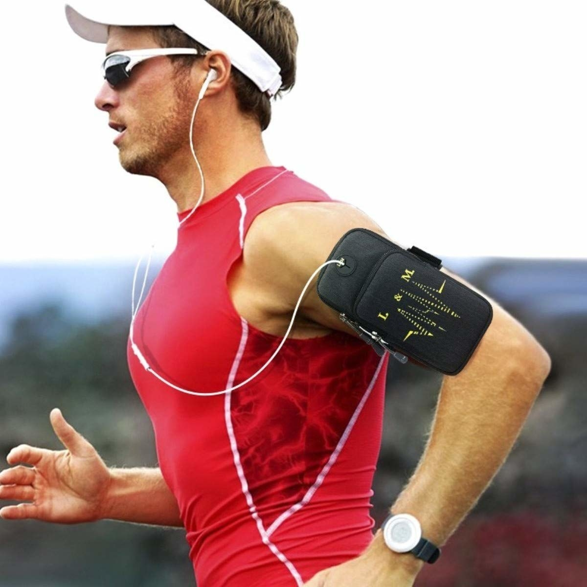 A man running with the zipped armband that contains a phone and connected earphones