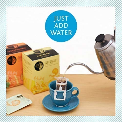 A cup with the easy-pour sachet in it and water being poured into it