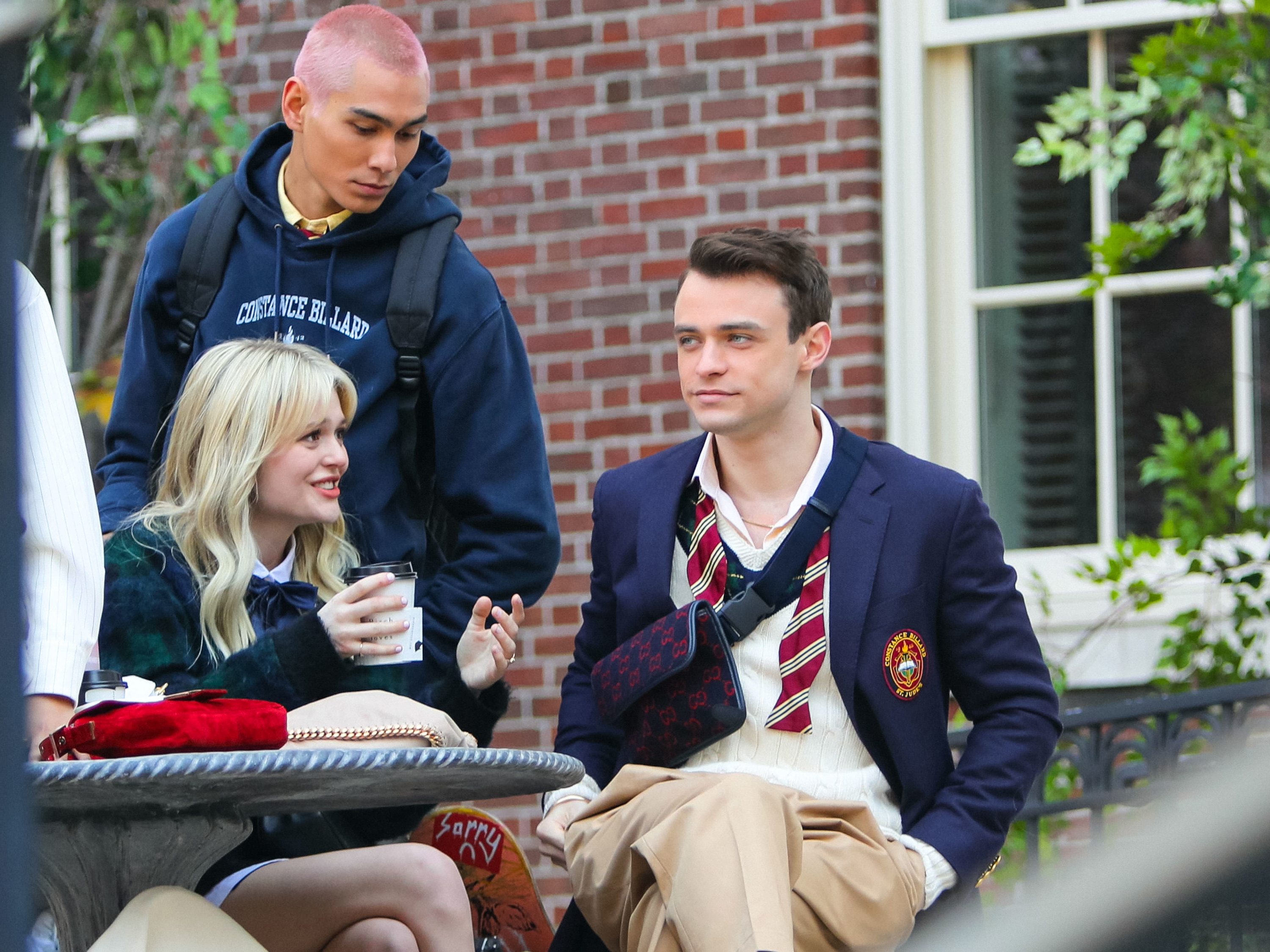 Thomas Doherty, Emily Alyn Lind and Evan Mock are seen at the film set of the 'Gossip Girl' TV Series on March 11, 2021 in New York City