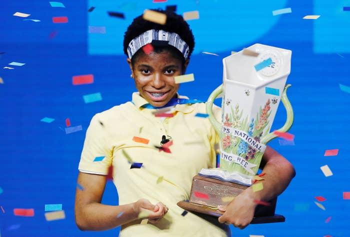 Zaila Avant-garde holds a trophy as confetti falls