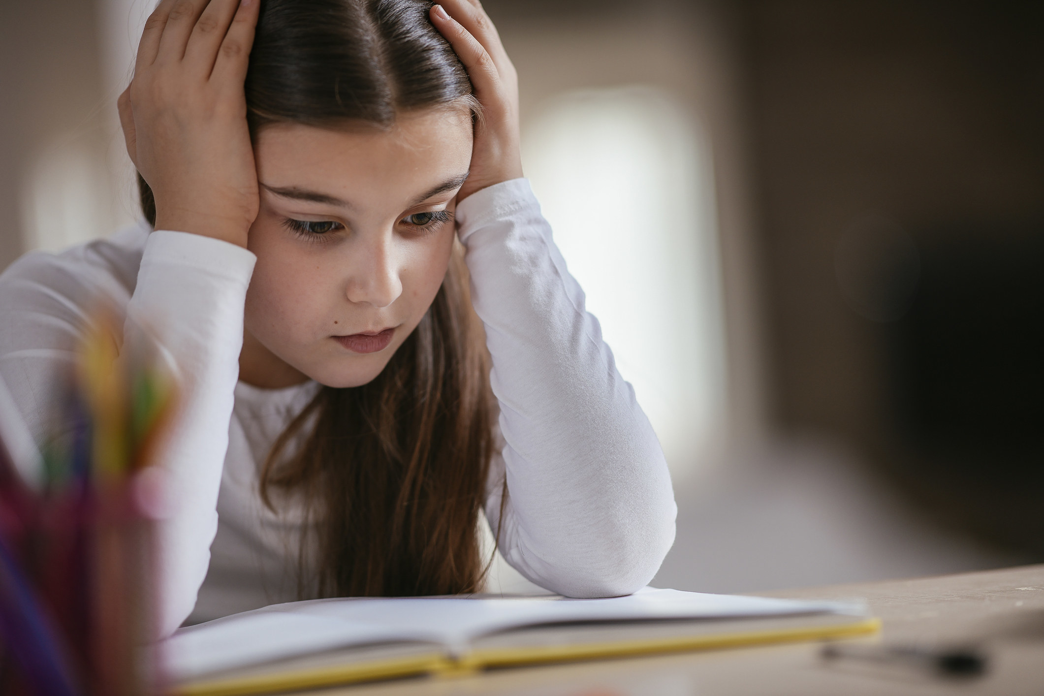 young girl struggling with her homework