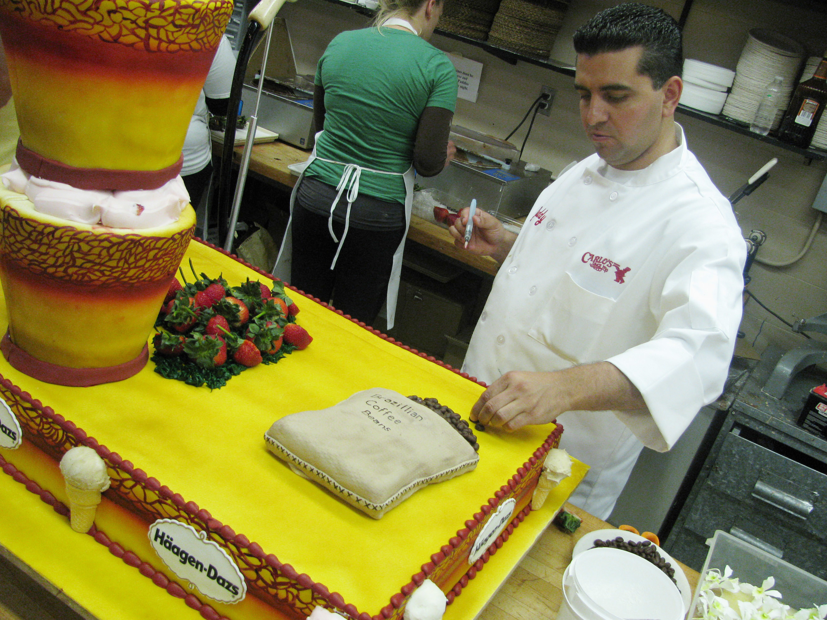Buddy decorates a huge and elaborate cake