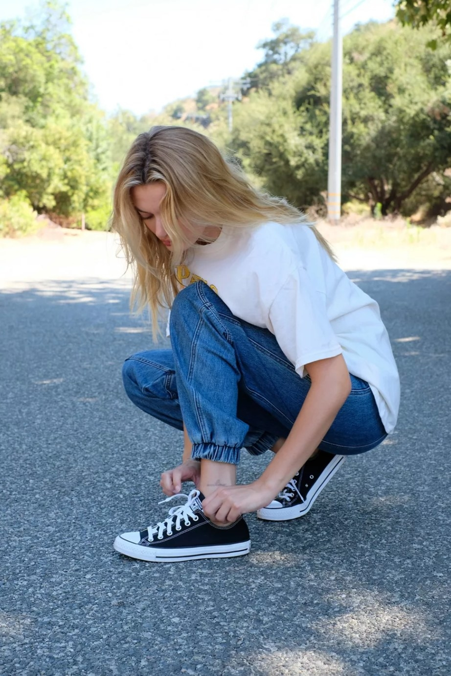 the Converse sneakers in black