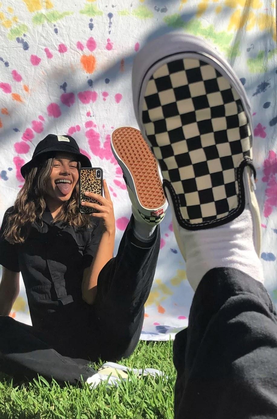 the Vans checkerboard slip-ons