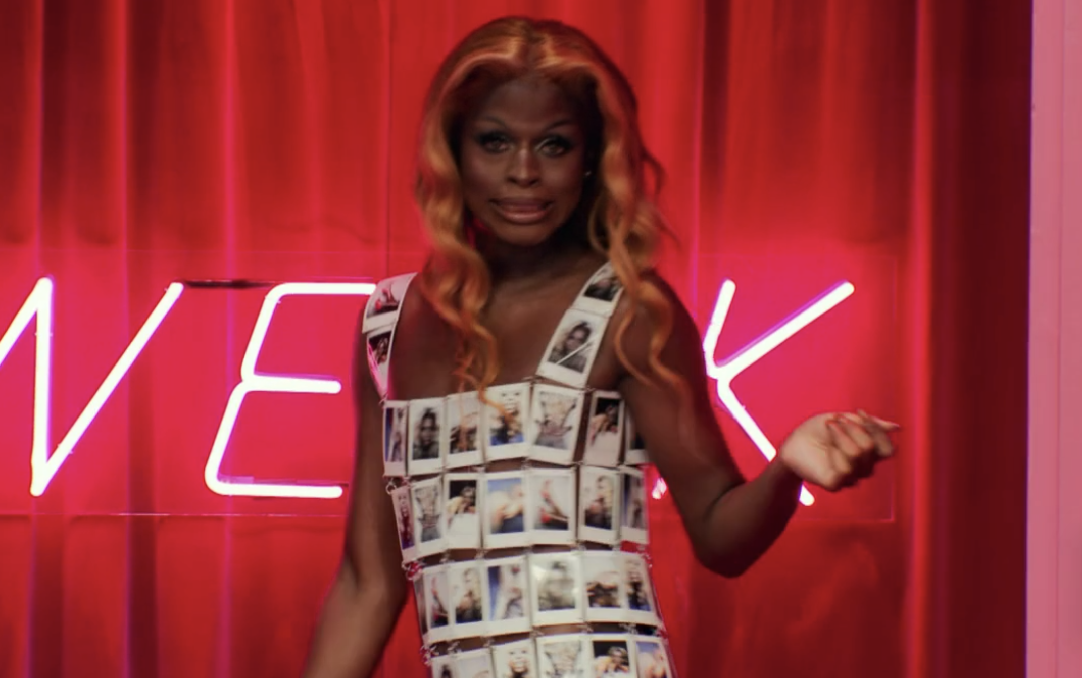 Symone wearing a dress made out of polaroids