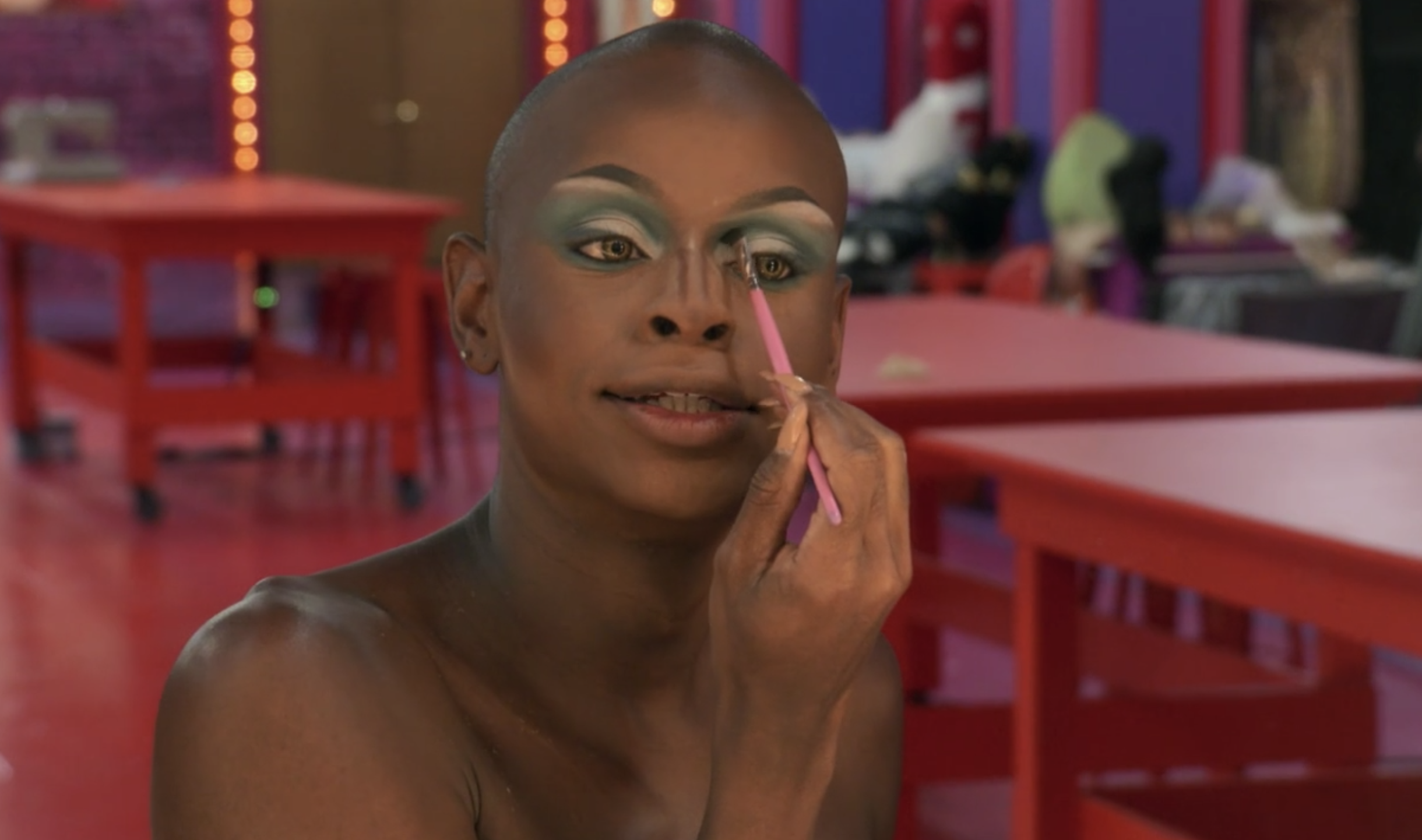 Symone doing her makeup