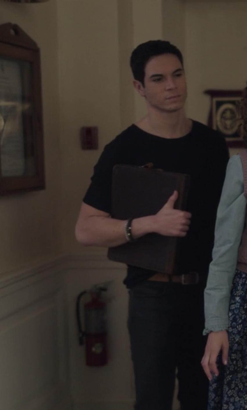 Jason Gotay in a tee shirt and jeans as Rafa Caparros
