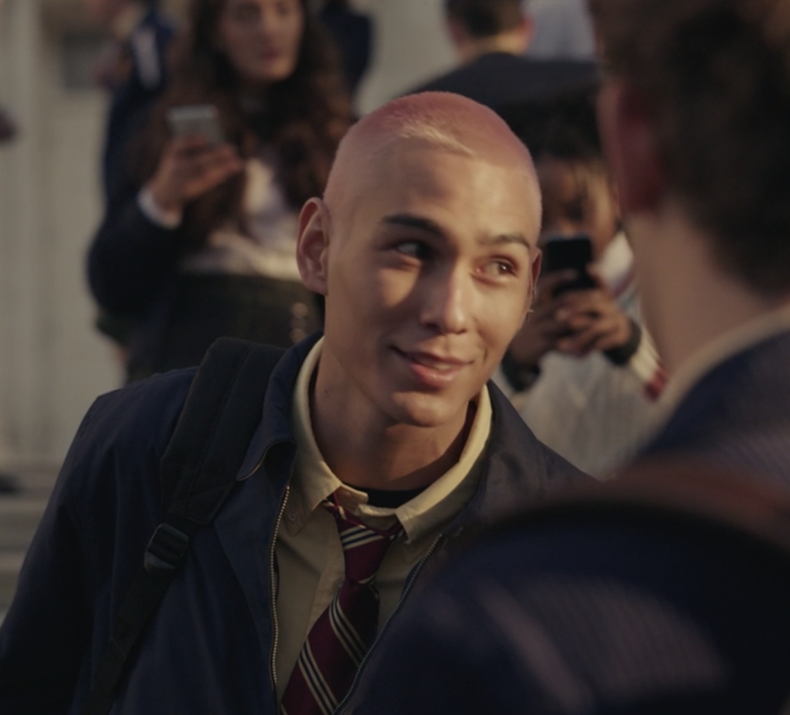 "Evan Mock in a school uniform as Akeno ""Aki"" Menzies"