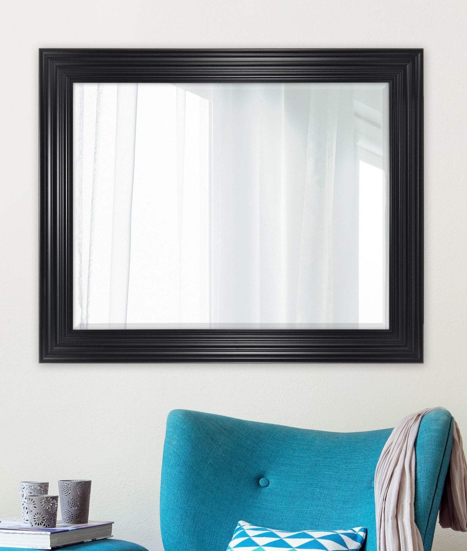 mirror hanging above living room furniture