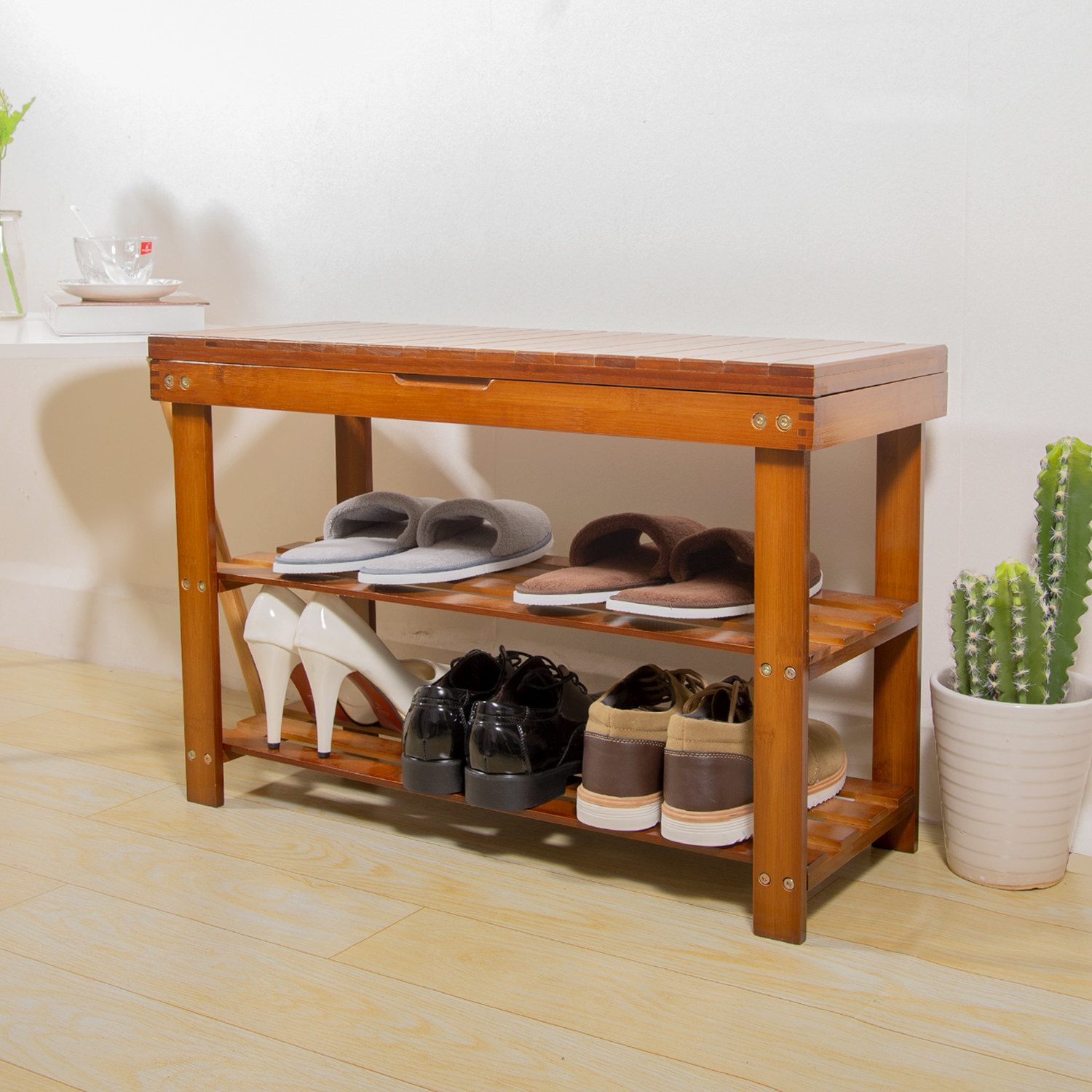 shoe rack in hallway with multiple pairs of shoes