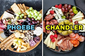 """On the left, a charcuterie board with various crackers, grapes, and meat with pistachios, blackberries, and figs labeled """"Phoebe,"""" and on the right, charcuterie board with olives, grapes, meats, cheeses, and berries labeled """"Chandler"""""""
