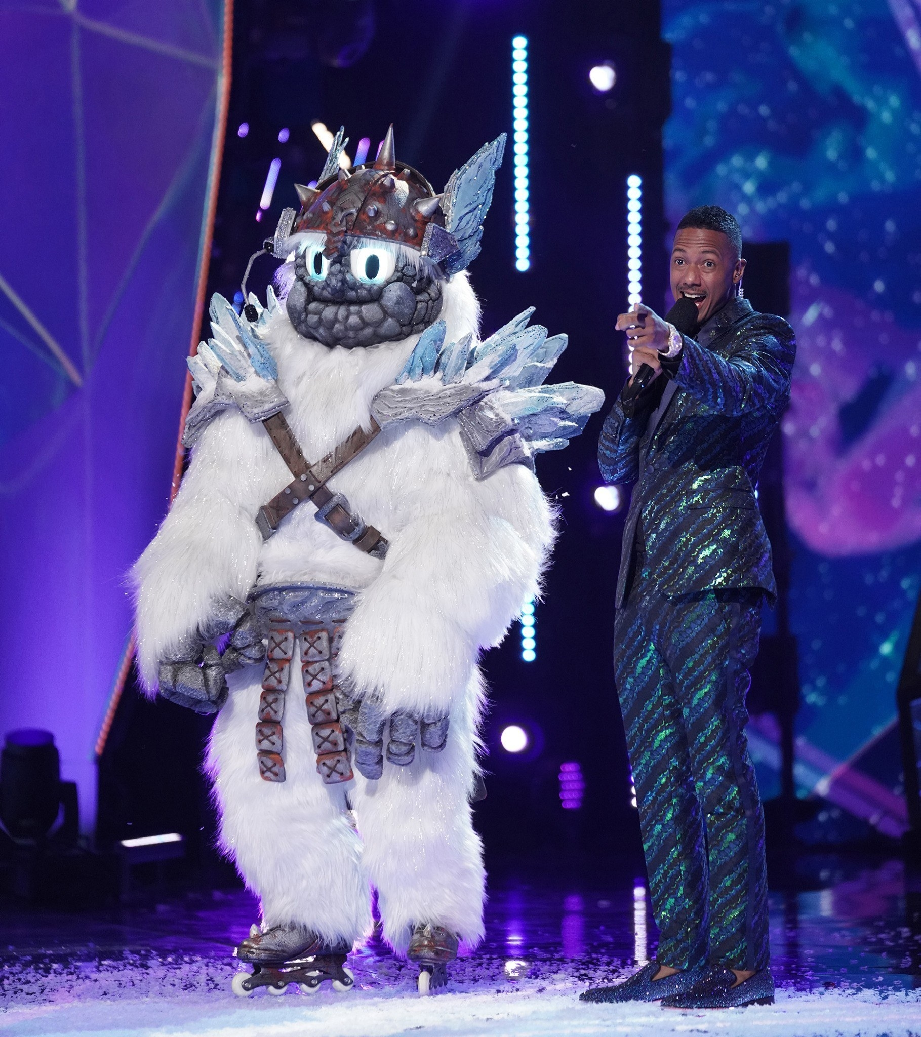 A scene from The Masked Singer with Nick Cannon and the Yeti
