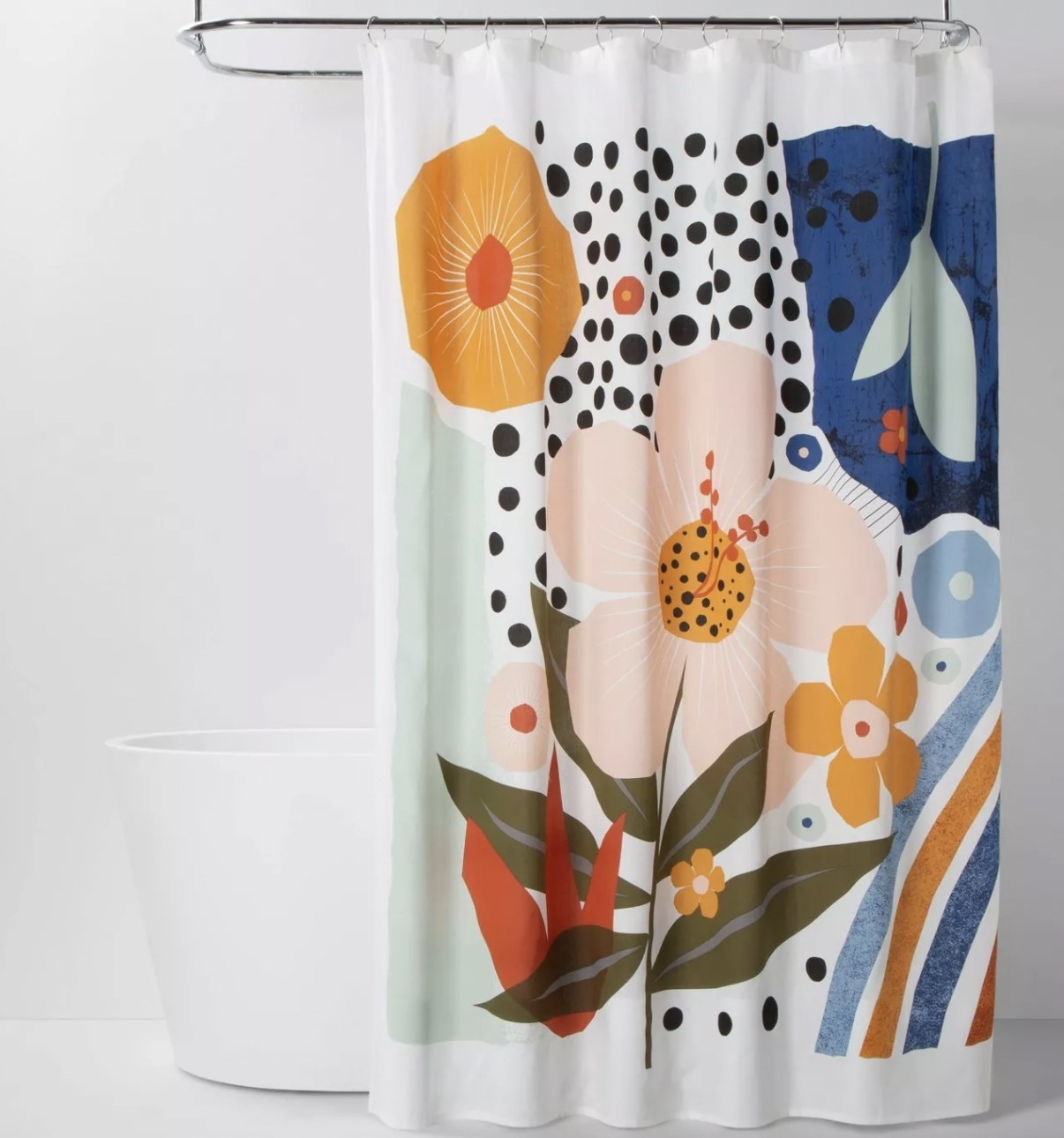 a shower curtain with graphic flowers on it