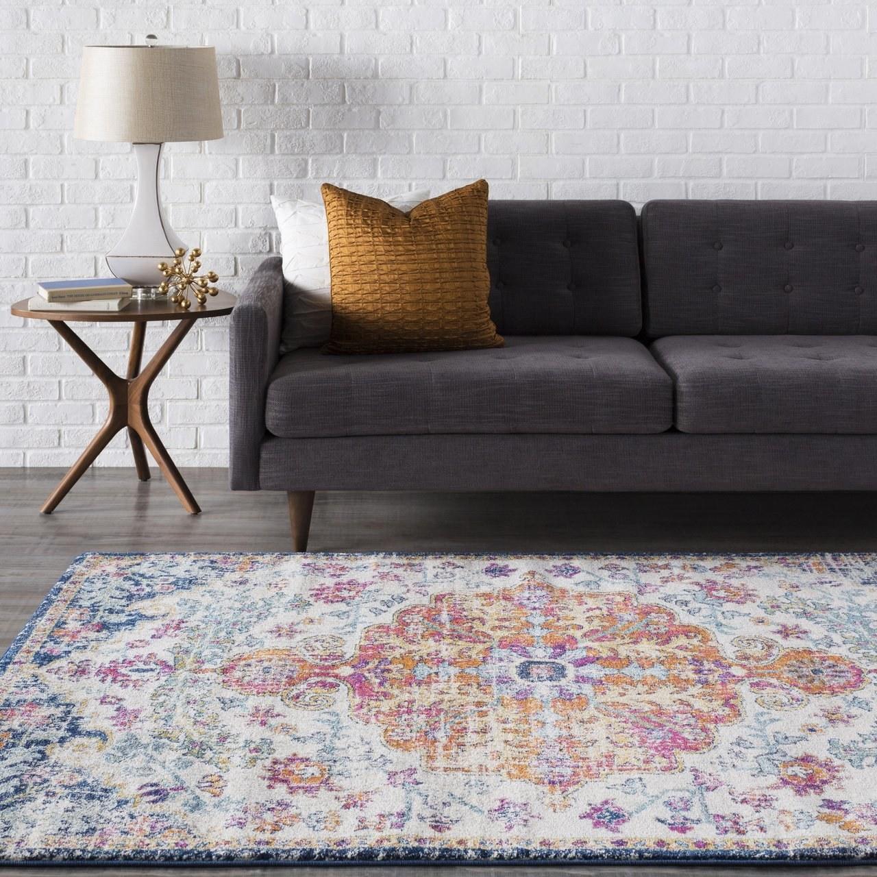 white, orange, pink, blue faux-distressed floral pattern rug
