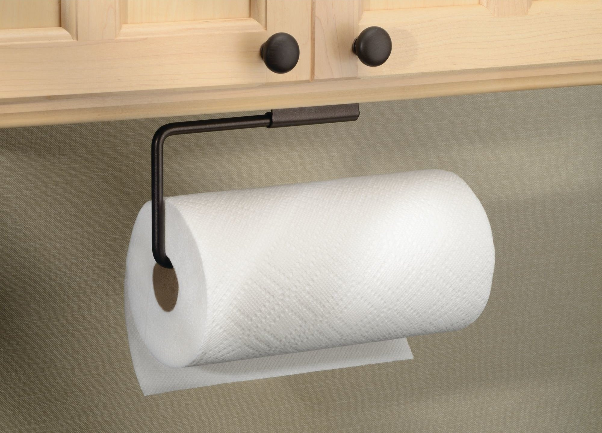 paper towel hanging underneath kitchen cabinets