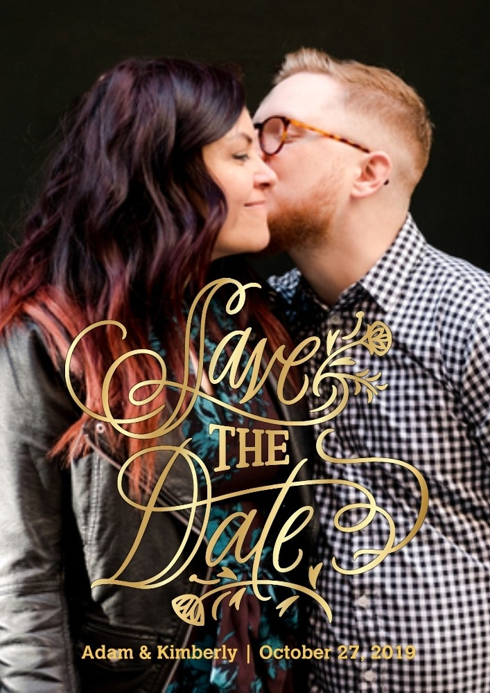 """A hetero-looking coupe kisses on the card announcing their nuptials. It says """"Save the Date,"""" their names, and a date."""