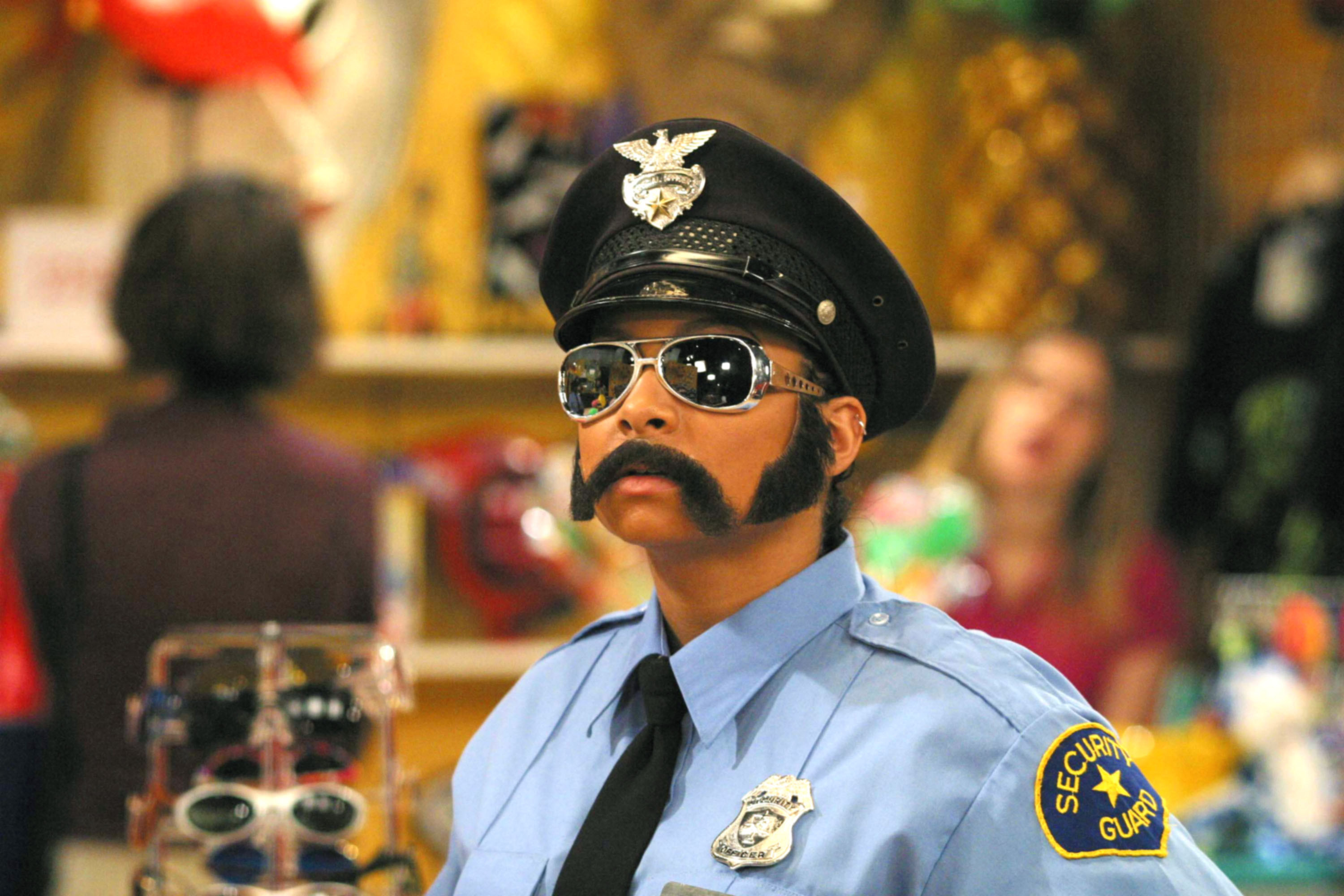 Raven-Symone dressed up like a male cop