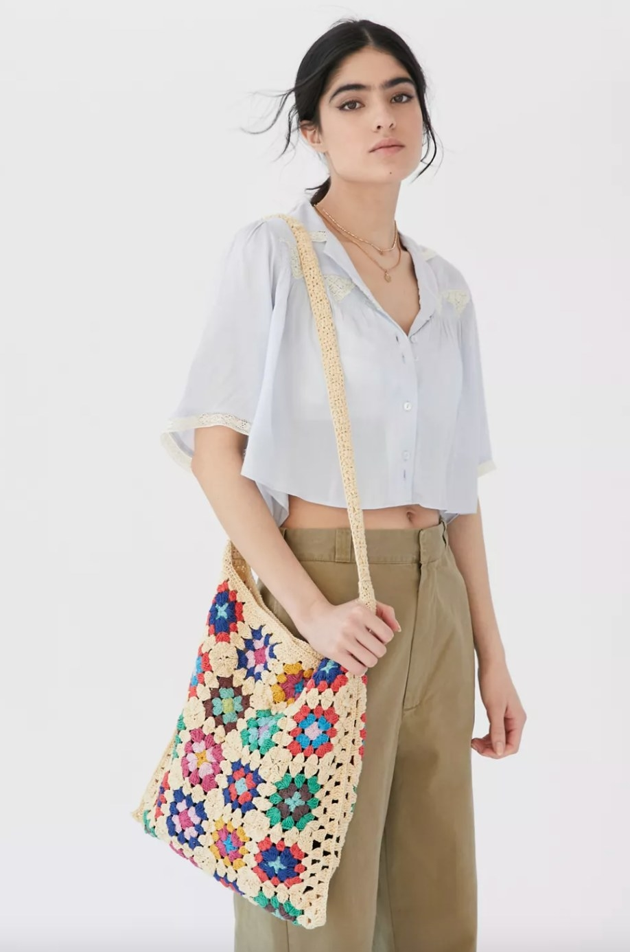 the crochet shoulder bag in nude and colorful