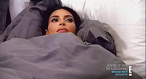 Kim Kardashian lying in bed
