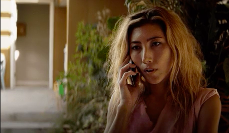 Woman looking kind of sad on phone