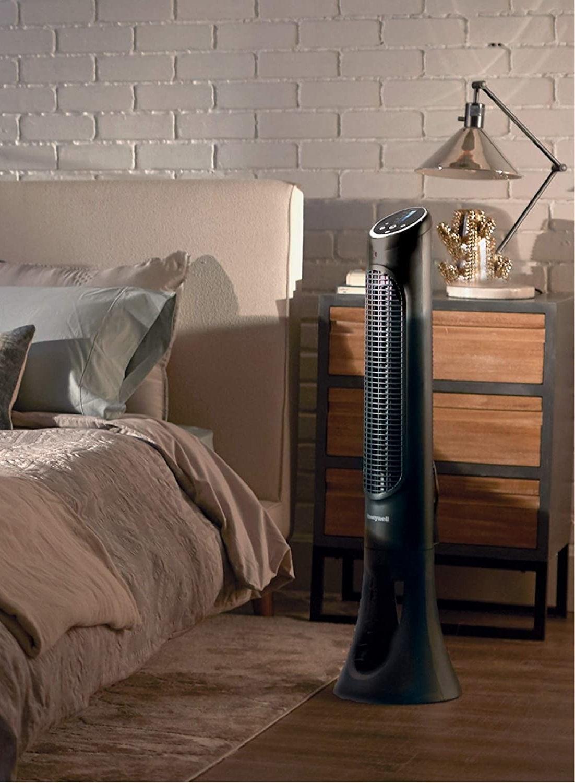the black tower fan in a bedroom