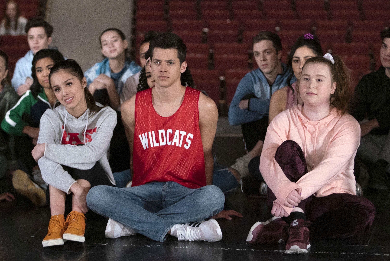 Olivia Rodrigo, Matt Cornett, and Julia Lester sit on the floor during auditions