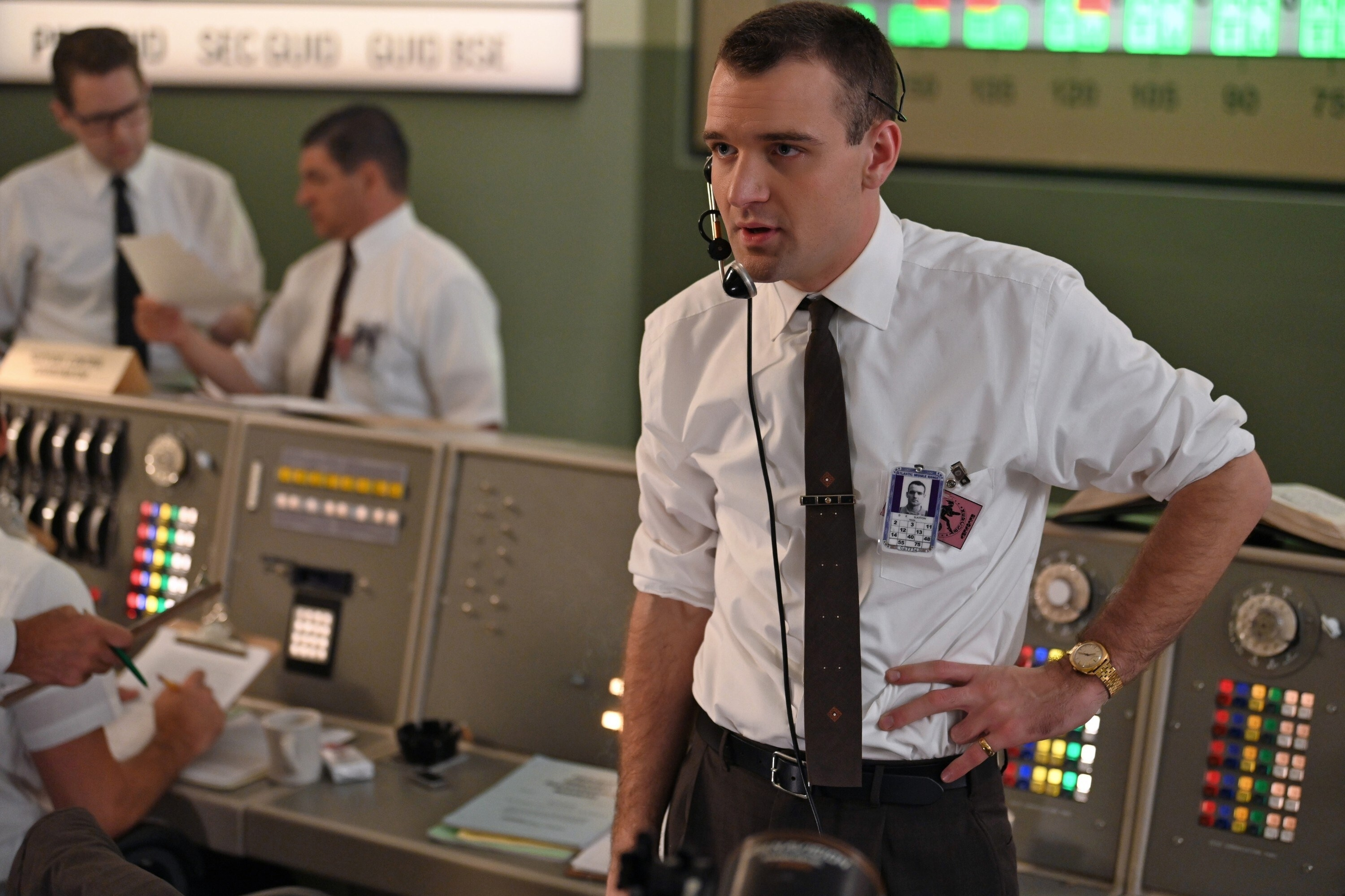 Micah Stock stands in mission control
