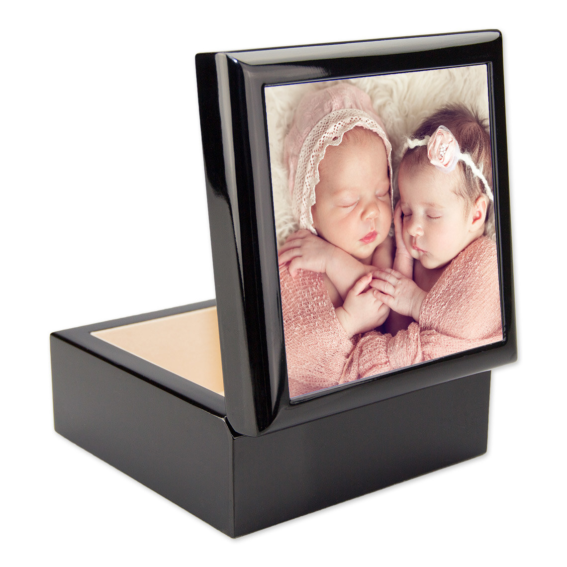 The black box with the photo tile on the lid. The box is open.