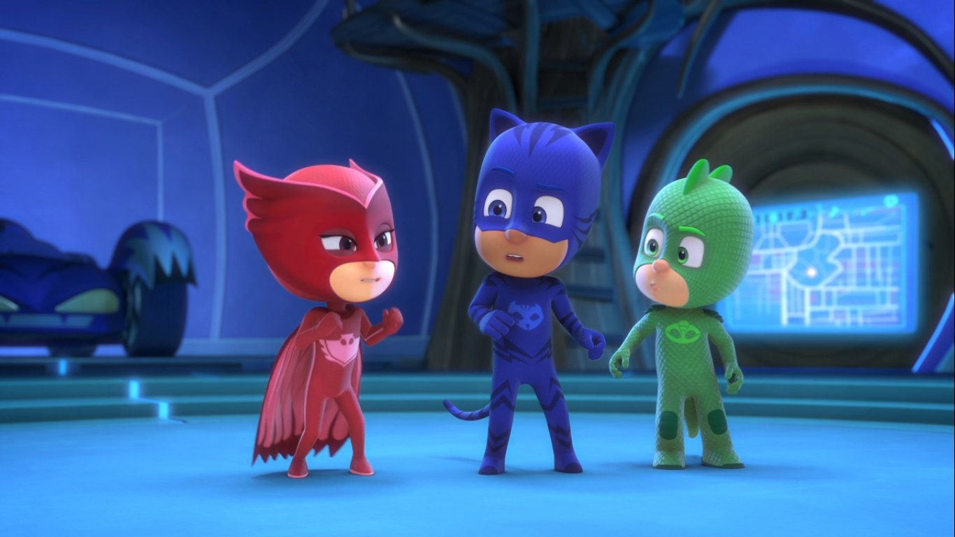 Owlette, Catboy, and Gekko stand wearing their supersuits